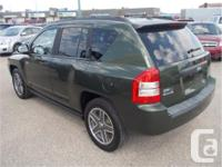 Make Jeep Model Compass Year 2009 Colour Dark Green