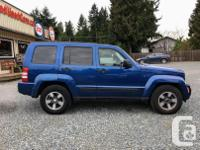 Make Jeep Model Liberty Year 2009 Colour Blue kms