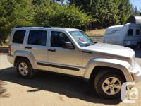 Make Jeep Year 2009 Colour Silver Trans Automatic kms