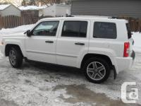 Make Jeep Model Patriot Year 2009 Colour White kms