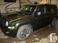 Make Jeep Model Patriot Year 2009 Colour Green kms