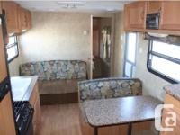 Great camper with bedroom in front with queen size bed