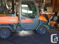 Colour Orange For sale is a 2009 Kubota RTV 1100 with