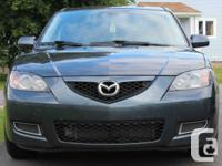 2009 Mazda 3, 4 door sedan. 2.0 L engine. 4 rate