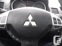 Make Mitsubishi Model Lancer Year 2009 Colour GREY kms