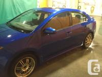 Make Nissan Model Sentra Year 2009 Colour Blue kms