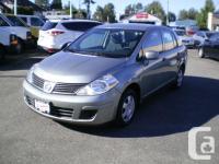 Make Nissan Model Versa Year 2009 Colour Grey kms