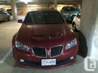 Make Pontiac Model G8 Colour Red Trans Automatic kms