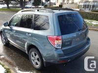 Make Subaru Year 2009 Colour Grey Trans Automatic kms
