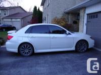 Make Subaru Model Impreza Year 2009 Colour white kms