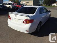 Make Toyota Model Corolla CE Year 2009 Colour WHITE