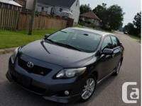 Make Toyota Model Corolla CE Year 2009 Colour gray kms