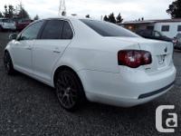 Make Volkswagen Model Jetta Year 2009 Colour white kms