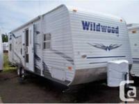 2009 Wildwood 27ft Travel Trailer No slide, A/C, front