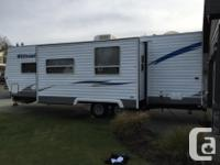 This used One Owner 2009 Forest River Wildwood 26BHSS