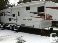 Like new 29.5ft Sunset Trail fifth wheel trailer.Bunk