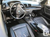 Make BMW Model 128i Year 2010 Colour Black kms 124000