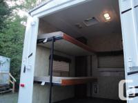 2010 Cougar 32' toy hauler with 2 slides. 2 fold up