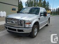 "Silver 2010 Ford F250 4WD. Extended taxicab, 80""box"