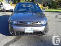 Make Ford Colour Grey Trans Manual kms 91000 2 door