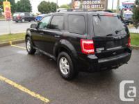 Make Ford Model Escape Year 2010 Colour Black kms