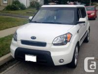 2010 Kia Soul 4U in white with automated transmission.