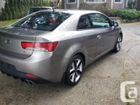 Make Kia Year 2010 Colour Grey with Black Leather