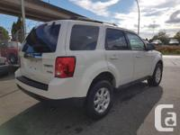 Make Mazda Model Tribute Year 2010 Colour White kms