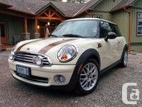 Make MINI Model COOPER Year 2010 Colour white and