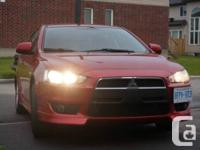 Make Mitsubishi Model Lancer Year 2010 Colour Red kms