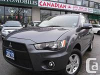 AUTOMATIC, GREY OVER BLACK INT, LS MODEL, 7-PASSENGER,