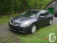 Make Nissan Model Altima Colour Charcoal Grey Trans