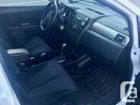 Make Nissan Model Versa Hatchback Year 2010 Colour