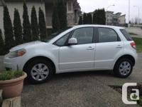 2010 Suzuki SX4, 4 door hatchback, white, gas,
