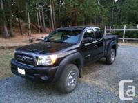 Make Toyota Model Tacoma Year 2010 Colour Black kms