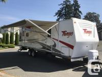 Can be pulled with 1/2 ton truck. Tango 306rlss. Rear