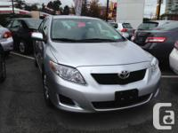 You are looking at a 2010 Toyota Corolla in Silver,