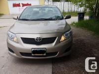 Make Toyota Model Corolla CE Year 2010 Colour Gold kms