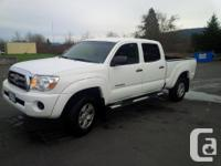 Make Toyota Model Tacoma Xtra Year 2010 Colour White