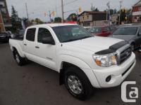 Make Toyota Model Tacoma Year 2010 Colour WHITE kms