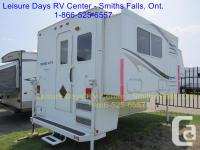 Ultra Series Slideout Truck Camper by Travel Lite,