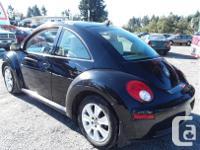 Make Volkswagen Model Beetle Year 2010 Colour Black