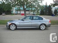 I AM SELLING AN 2011 BMW 323I GRAK GREY WITH 15,000KMS