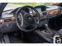 Make BMW Model 335i Year 2011 Colour Black kms 42605