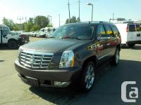 Make Cadillac Year 2011 Colour Brown Trans Automatic