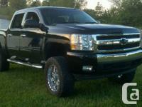 I have a beautiful Black 2011 Chevrolet Silverado 1500