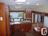 2011 KEYSTONE COUGAR 5TH WHEEL - 278 RKS MODEL