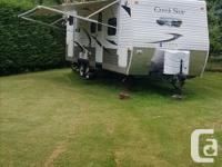"2011 Creekside 26 bks trailer. Approx. 28"" length,"