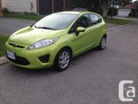 Make Ford Model Fiesta Year 2011 Colour lime green kms