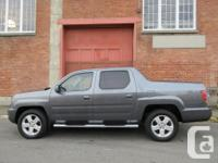 Make Honda Model Ridgeline Year 2011 Colour Grey kms